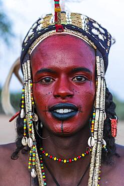 Wodaabe-Bororo man with face painted at the annual Gerewol festival, courtship ritual competition among the Fulani ethnic group, Niger, Africa