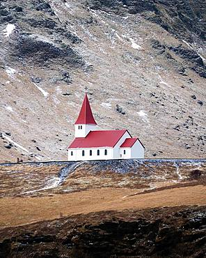 Small church with red roof in Vik from a distance, Vik, Iceland, Europe