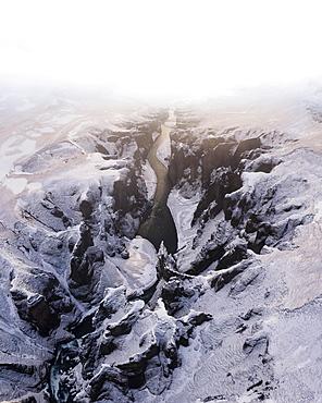 Aerial view, Fjaorargljufur Canyon with golden light and clouds, Kirkjubaejarklaustur, Iceland, Europe