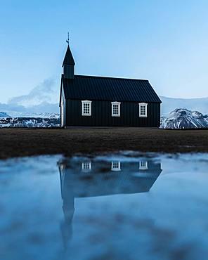 Black small church with reflection, Buakirkja, Arnarstapi, Iceland, Europe