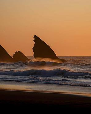 Sunset at Praia da Adraga with rock, Almocageme, Portugal, Europe