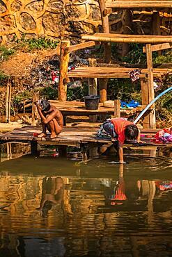 Children washing in the river, lake Inle, Myanmar, Asia