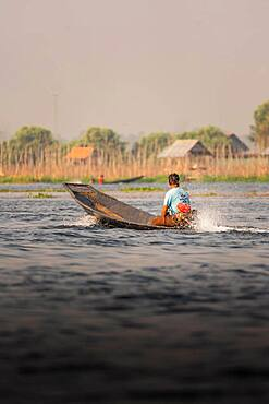 Fisherman takes his boat out on Lake Inle, Myanmar, Asia
