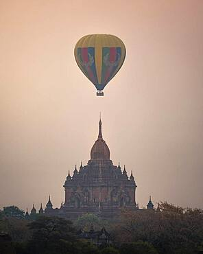 Colorful balloon in the middle of the Htilominlo Temple, Bagan, Myanmar, Asia
