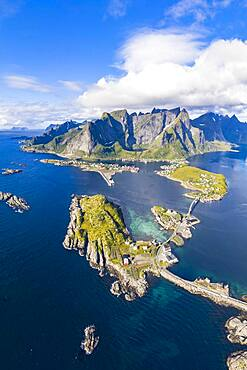 View of islands, fjord and mountains, fishing villages Sakrisoy and Reine, Reinefjord, Lofoten, Norway, Europe