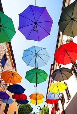 Colorful umbrellas as decoration in the old town, Novigrad, Adriatic coast, Istria, Croatia, Europe