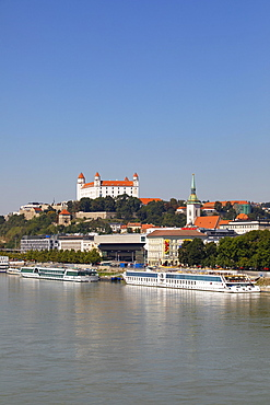 Landing stage for Danube cruise ships with a view to Bratislava Castle, Danube, Bratislava, Slovakia, Europe
