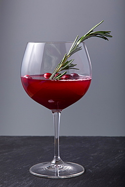 Cranberry cocktail on black surface