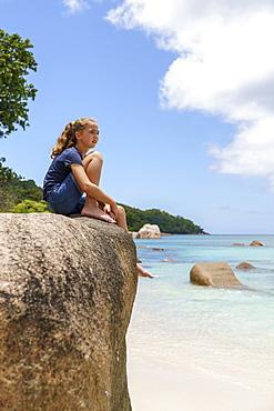Girl on rocks, Anse Lazio, Praslin, Seychelles, Africa