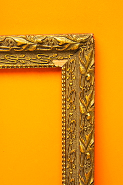 Broken frame on a orange background, France, Europe