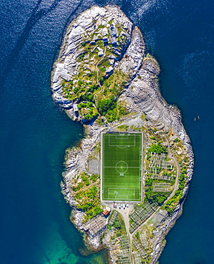 Aerial view, Henningsvaer with football stadium, rock island in the sea, Vestvagoy, Lofoten, Nordland, Norway, Europe