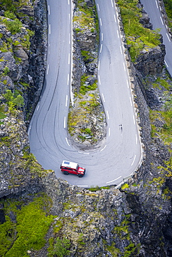 Single car, hairpin bend at the mountain road Trollstigen, near Andalsnes, More og Romsdal, Vestland, Norway, Europe