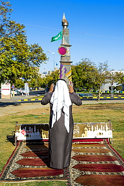 Man praying on a mobile praying rug, Abha, Saudi Arabia, Asia