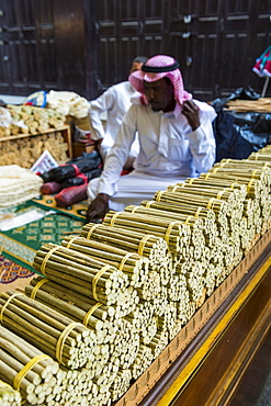 Man selling chewing sticks, old town of Jeddah, Saudi Arabia, Asia