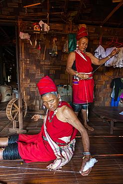 Old Kayan women weaving the traditional way, Kayah village, Loikaw area, Kayah state, Myanmar, Asia