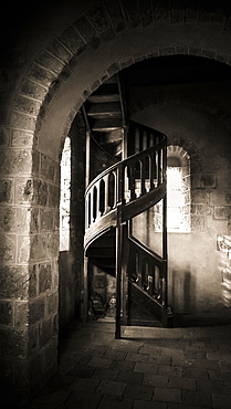 Wooden spiral staircase in a church, France, Europe