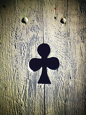 Clover shape cut out of wooden door