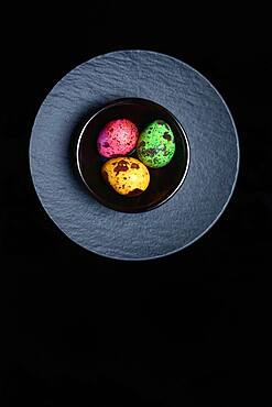 Coloured quail eggs in small bowls, Easter eggs, Germany, Europe