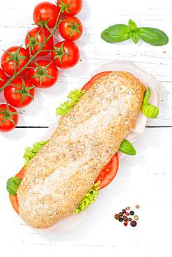 Sandwich baguette wholemeal roll topped with ham from the top on