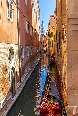 Narrow canal with gondola, view of Campanile di San Marco bell tower, Venice, Veneto, Italy, Europe