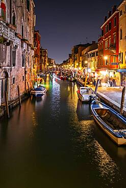 Evening atmosphere, streetlights, canal with boats and historical buildings, light traces, Venice, Veneto, Italy, Europe
