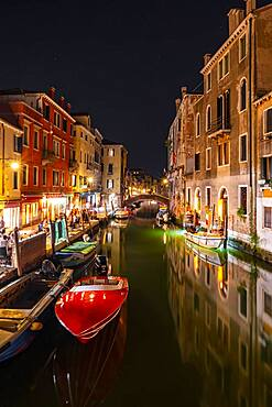 Evening atmosphere, streetlights, boats on canal and historical buildings, Venice, Veneto, Italy, Europe