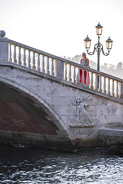 Young woman tourist walking over a bridge, Venice, Veneto, Italy, Europe