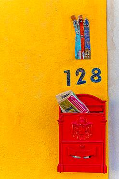 Letterbox and house number on a yellow house wall, Burano Island, Venice, Veneto, Italy, Europe