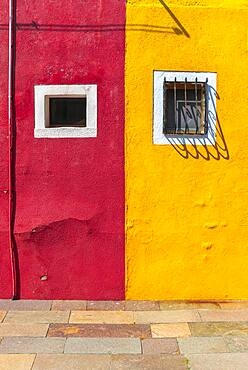 Red and yellow wall with window, colorful house wall, colorful facade, Burano Island, Venice, Veneto, Italy, Europe