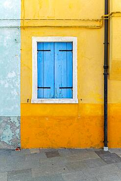 Yellow house with blue window, colorful houses, colorful facade, Burano Island, Venice, Veneto, Italy, Europe