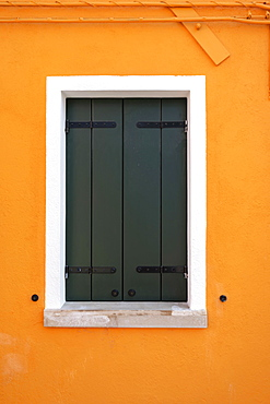 Orange wall with window, colorful house wall, closed shutters, colorful facade, Burano Island, Venice, Veneto, Italy, Europe
