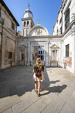 Young woman in front of church San Giovanni Evangelista, Venice, Veneto, Italy, Europe
