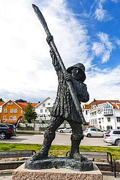 Statue in the harbour of the historic harbour town Grimstad, Norway, Europe