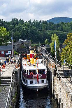 Tourist boat in the Ulefoss locks, Telemark Canal, Norway, Europe