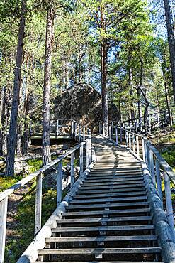 """Wooden stairs to the """"""""Bear's Den"""""""" Tafone Rock, Lapland, Inari, Finland, Europe"""