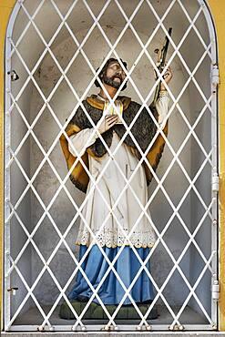 Figure of saint behind lattice, Bad Toelz, Upper Bavaria, Bavaria, Germany, Europe