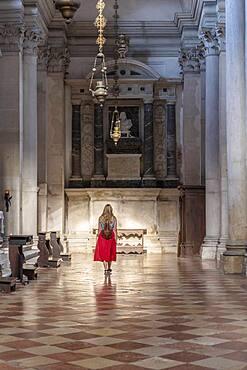Young woman with dress in San Giorgio Maggiore church, Venice, Veneto, Italy, Europe