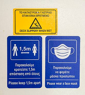 Warning and information signs on a Greek ferry, distance regulations during Corona, Covid-19 in Greece on a ferry, Greece, Europe