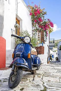 Blue scooter, Vespa, in an alley, Lefkes, Paros, Cyclades, Aegean Sea, Greece, Europe