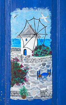 Painting on a house wall, Greek motif with sea and windmill
