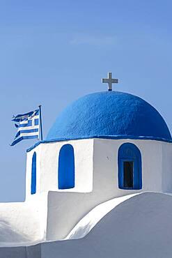 Blue and White Greek Orthodox Church Agios Nikolaos with Greek Flag, Parikia, Paros, Cyclades, Aegean Sea, Greece, Europe