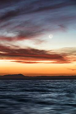 Moon at sunset at Lake Taupo, Waikato, North Island, New Zealand, Oceania