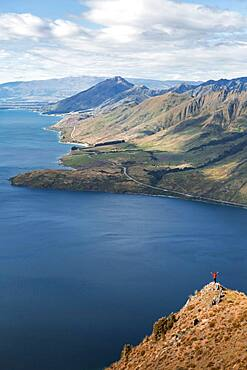 Guy on a mountain at Lake Hawea, Otago Region, Queenstown-Lakes District, South Island New Zealand