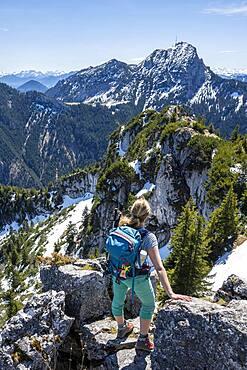 Hiker on the summit of Breitenstein, behind Wendelstein, Fischbachau, Bavaria, Germany, Europe