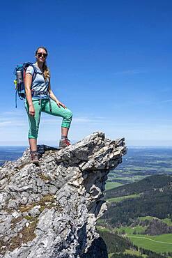 Hiker on the summit of Breitenstein, view over alpine foreland, Fischbachau, Bavaria, Germany, Europe
