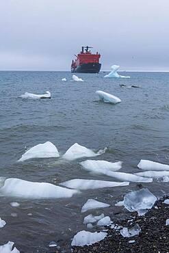 Icebreaker anchoring behind a iceberg, Champ Island, Franz Josef Land archipelago, Russia, Europe