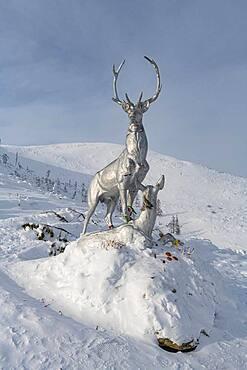 Deer monument on a snow covered mountain pass, Suntar-Khayata mountain Range, Road of Bones, Sakha Republic, Yakutia, Russia, Europe
