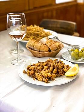 Fried small squid with lemon and white bread, Majorca, Puerto Andratx, Majorca, Spain, Europe