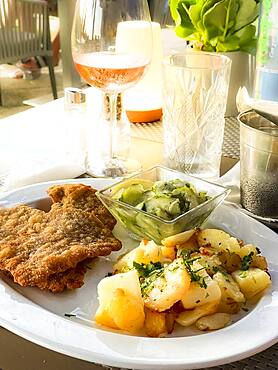 Original Viennese veal escalope with fried potatoes and cucumber salad, Port Andratx, Majorca, Spain, Europe