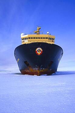 Russian Icebreaker Kapitan Khlebnikov parked in the frozen sea at Atka Iceport or Atka Bay, Weddell Sea, Antarctica
